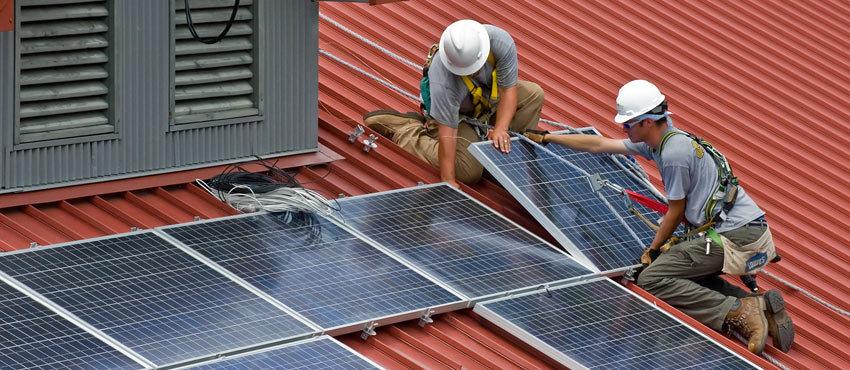 Solar panel construction workers