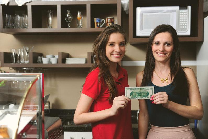 Entrepreneurs holding a dollar