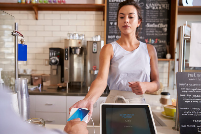 Waitress accepting contactless EMV payment