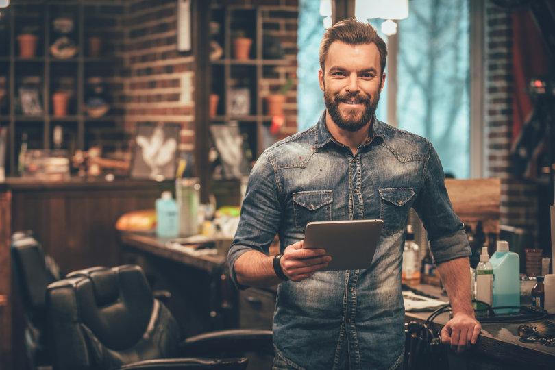 Barbershop owner doing digital marketing