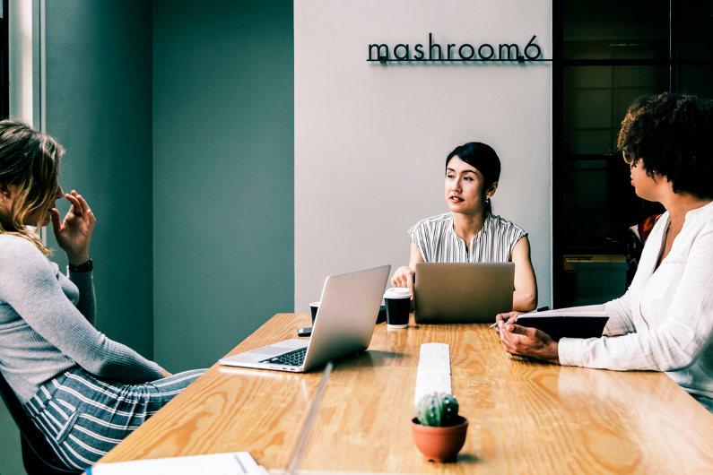 Businesswomen using tech resources