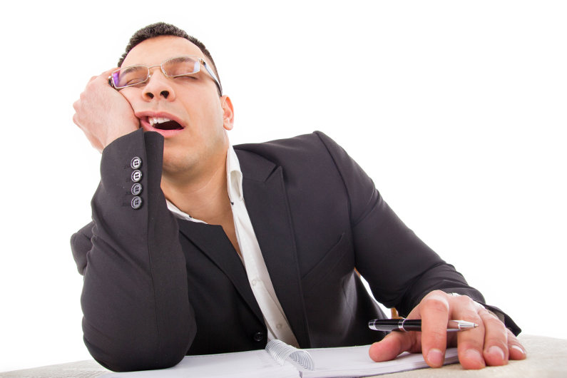 Sleepy businessman after a vacation