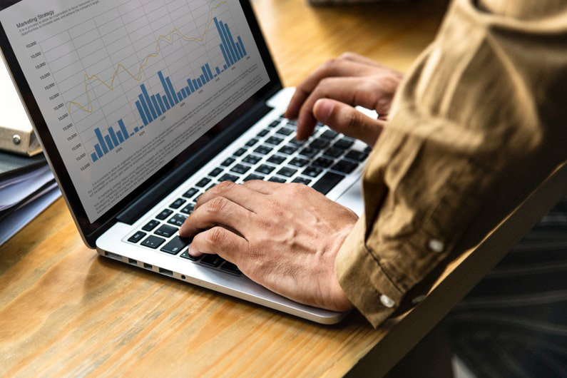 Businessman using financial management app