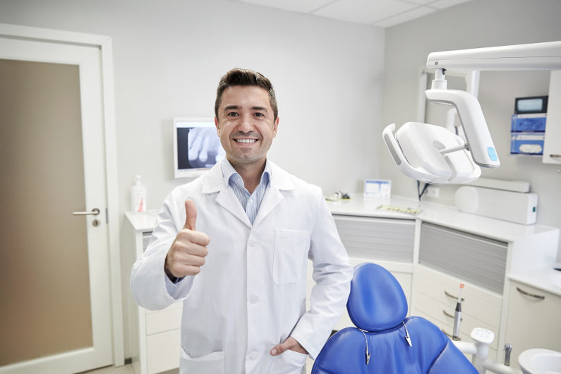 Dentist in dental practice