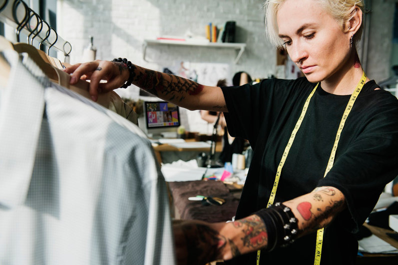 Fashion designer managing her brands