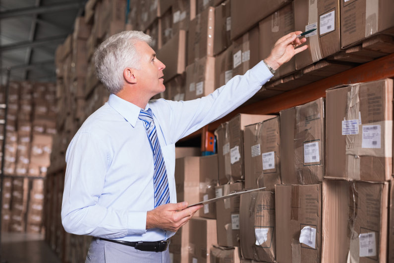 Warehouse manager managing inventory
