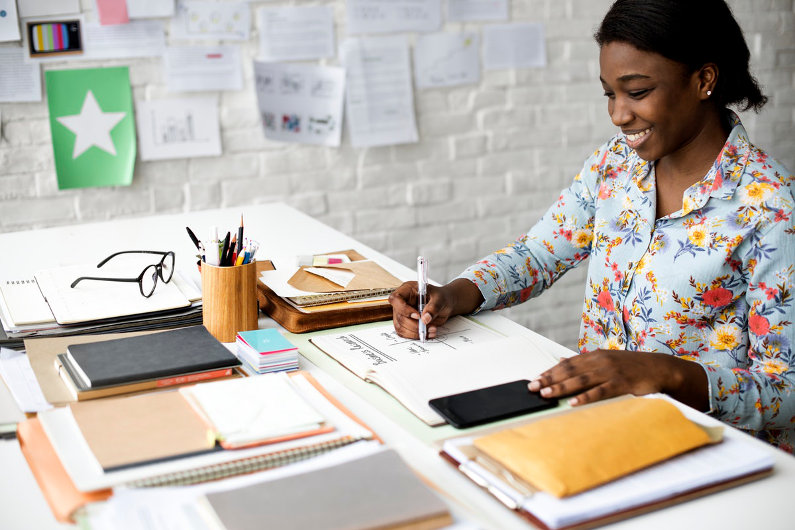 Businesswoman work on her tidy desk at home office