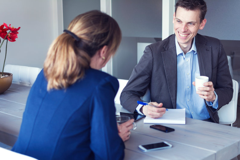 Woman in blue in a job interview
