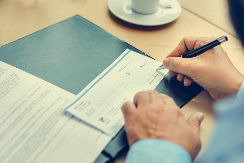Businessman writing cheque