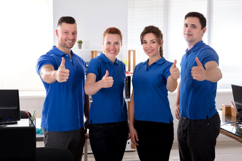 Staff wearing company uniforms