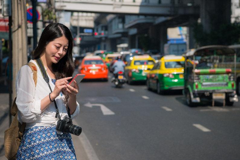 Woman using ridesharing app