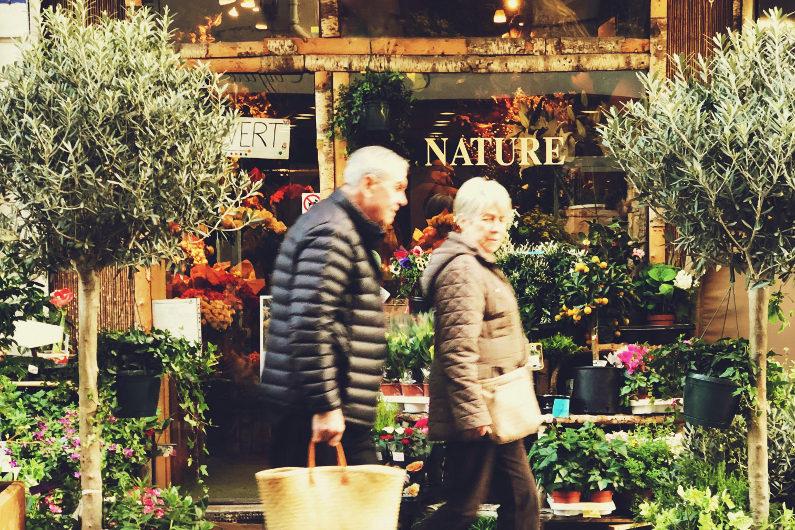 Elderly shoppers on high street shops