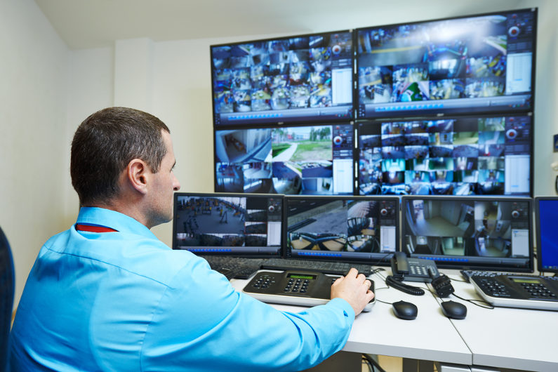 Security officer monitoring CCTV cameras