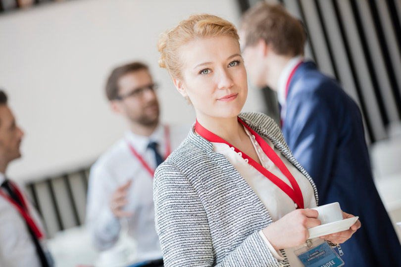 Businesswoman attending business convention