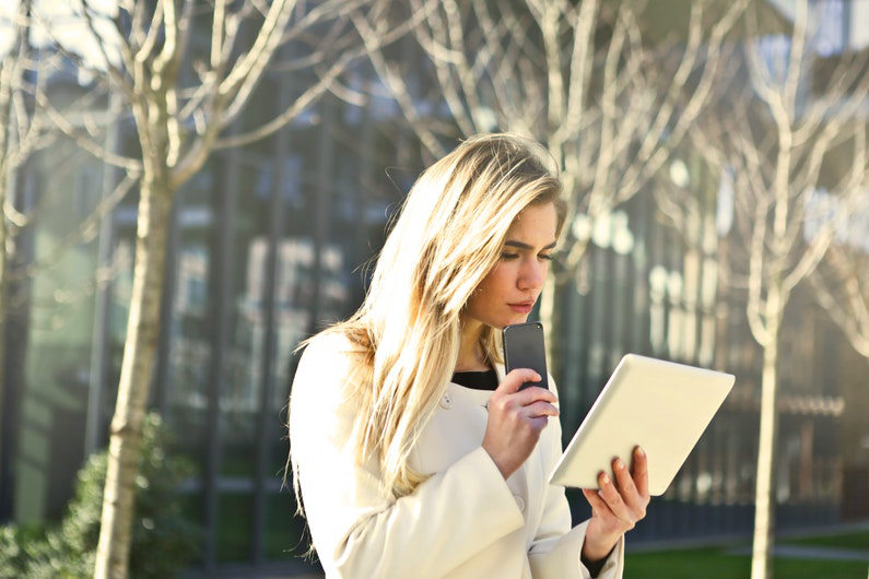 Businesswoman using mobile device with business-specific plan