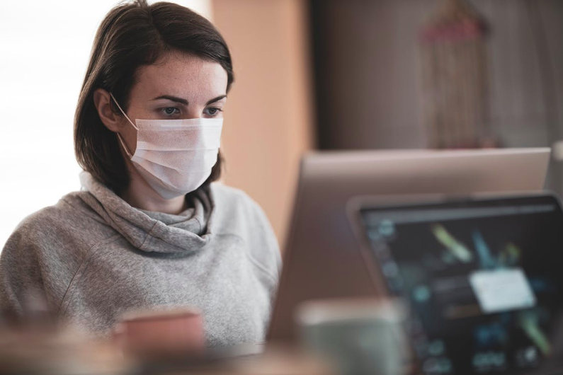 Businesswoman wearing mask at work