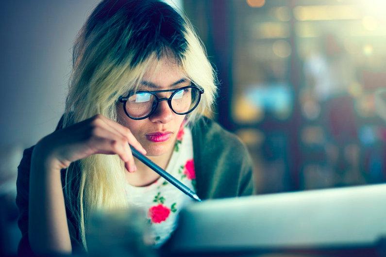 Businesswoman using blue light glasses