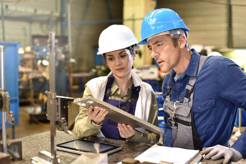 Manufacturing managers wearing hardhat
